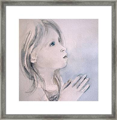 She Prays Framed Print