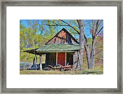 Shed And Wheelbarrows Framed Print