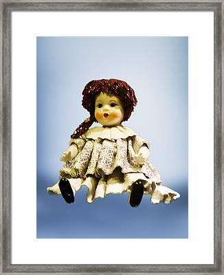 Shinny Porcelain Doll Framed Print by Linda Phelps