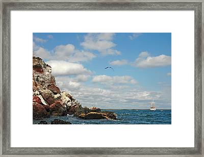 Ship Off Shore Framed Print by Alan Lenk