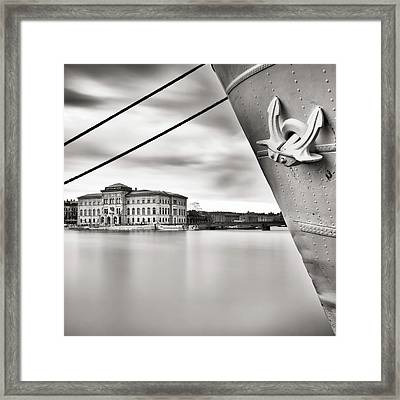 Ship With Anchor In Harbor Framed Print by Peter Levi