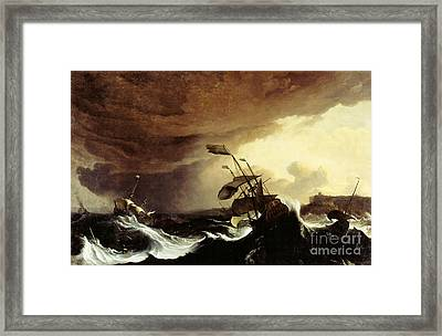 Ships In A Stormy Sea Off A Coast Framed Print