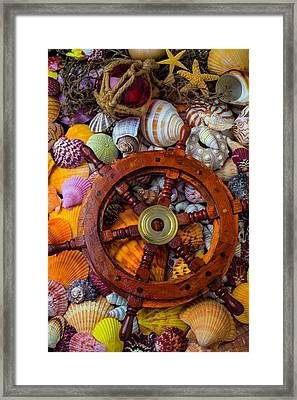 Ships Wheel Among Seashells Framed Print