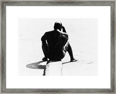 Shirtless Seated Man At Coney Island Framed Print by Nat Herz