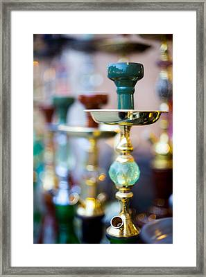 Shisha Pipes Lined Up In A Doha Souq Framed Print by Paul Cowan