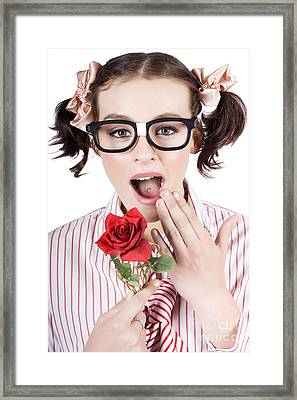 Shocked Romantic Nerdy Girl Holding Red Rose Framed Print by Jorgo Photography - Wall Art Gallery