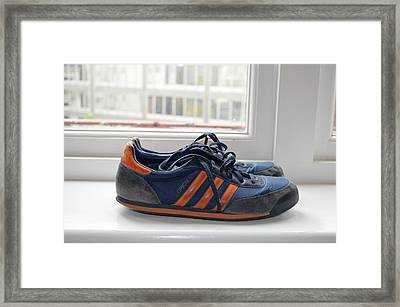 Shoes In The Window Framed Print by Erik Burg