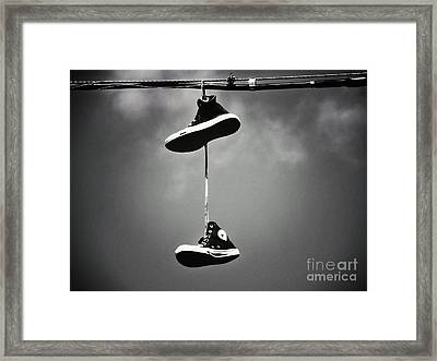 Shoes On A Wire Framed Print by Christina Stanley