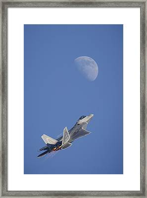 Shoot The Moon Framed Print by Adam Romanowicz