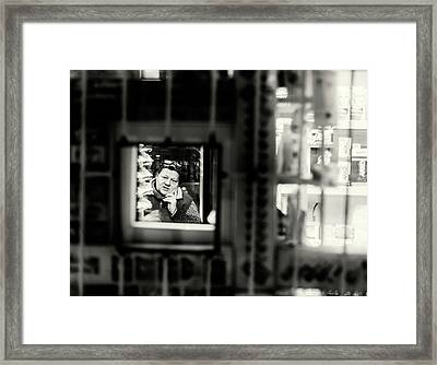 Framed Print featuring the photograph Shopkeeper At Night by John Williams