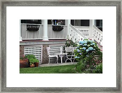 Shore Table And Chairs Framed Print by John Rizzuto