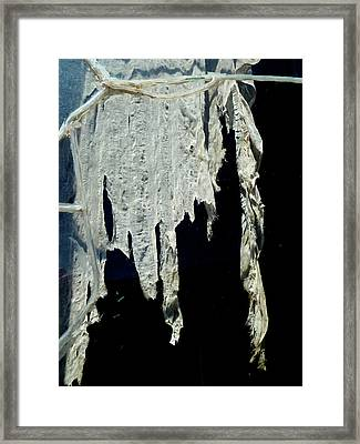 Shredded Curtains Framed Print