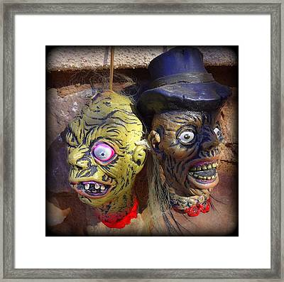 Shrunken Heads Framed Print