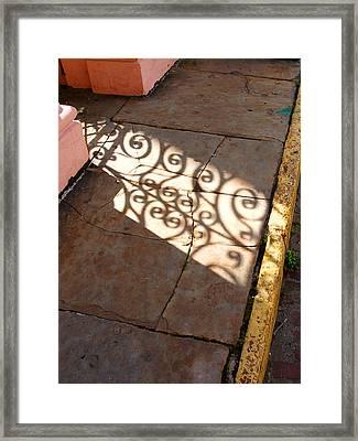 Sidewalk Shadow Framed Print