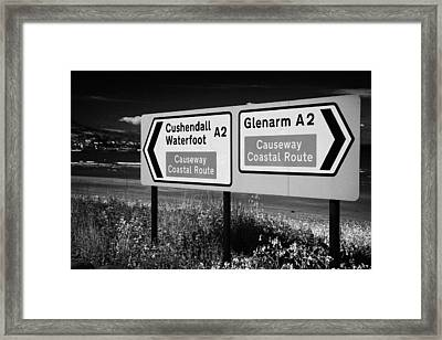 Signposts For The Causeway Coastal Route At Carnlough Between Cushendall And Glenarm County Antrim Framed Print by Joe Fox