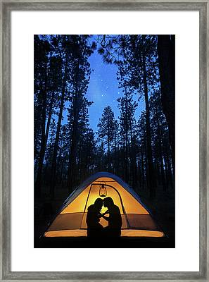 Silhouette Couple Camping Under Stars In Tent Framed Print by Susan Schmitz