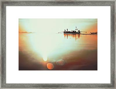 Silhouette Of A Thai Fisherman Wooden Boat Longtail During Beautiful Sunrise Thailand Framed Print
