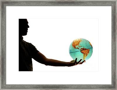 Silhouette Of Man Holding Globe Framed Print