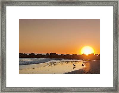Silhouette Of Rocks On Beach At Sunset Framed Print