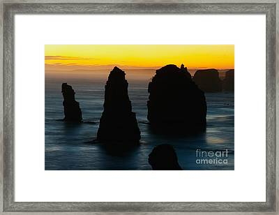 Silhouette Of The Twelve Apostles At Sunset Framed Print by Hideaki Sakurai