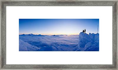 Silhouette Of Two Hikers Standing Framed Print by Panoramic Images
