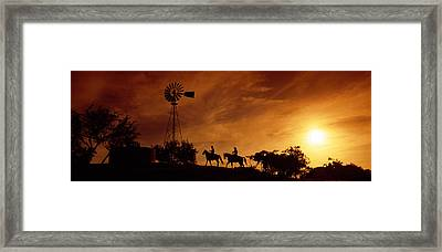 Silhouette Of Two Horse Riders Framed Print