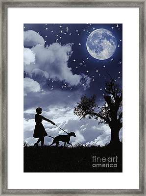 Silhouette Of Woman Walking Her Dog Framed Print