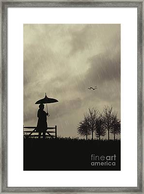 Silhouette Of Woman With Umbrella Framed Print by Amanda Elwell