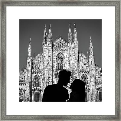 Silhouette Of Young Couple Kissing In Front Of Milan's Duomo Cathedral Framed Print