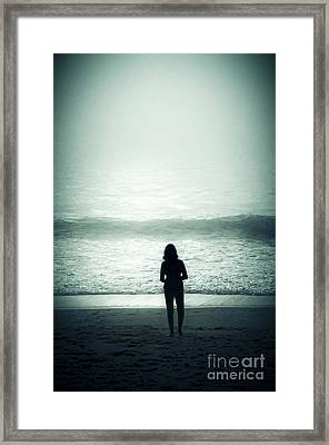 Silhouette On The Beach Framed Print