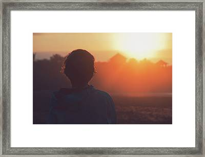 Silhouette Portrait Of A Young Woman With Short Hair Watching Beautiful Sunset Framed Print