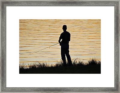 Framed Print featuring the photograph Silhouetted Fisherman by Teresa Blanton