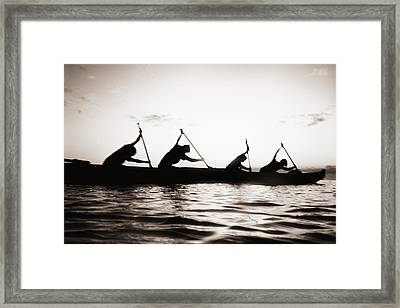 Silhouetted Paddlers Framed Print