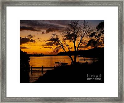 Silhouettes At Sunrise Framed Print