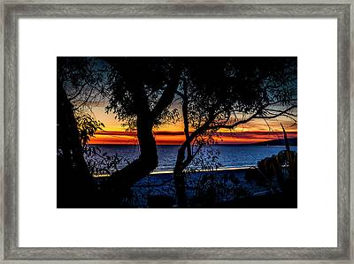 Silhouettes Over Blue Water Framed Print