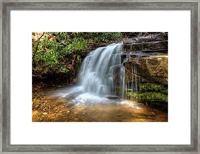Silky Waterfall Framed Print by Debra and Dave Vanderlaan