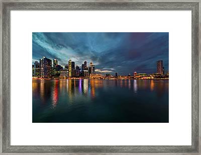 Singapore City Skyline At Evening Twilight Framed Print by David Gn