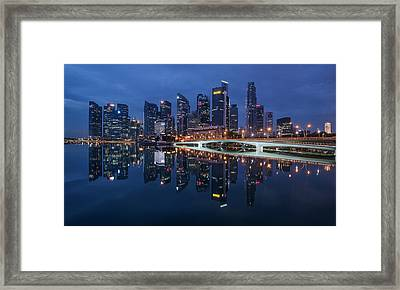 Framed Print featuring the photograph Singapore Skyline Reflection by Pradeep Raja Prints