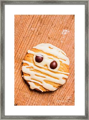 Single Homemade Mummy Cookie For Halloween Framed Print by Jorgo Photography - Wall Art Gallery