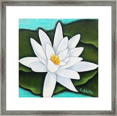 Single White Water Lily Framed Print by Lorraine Klotz