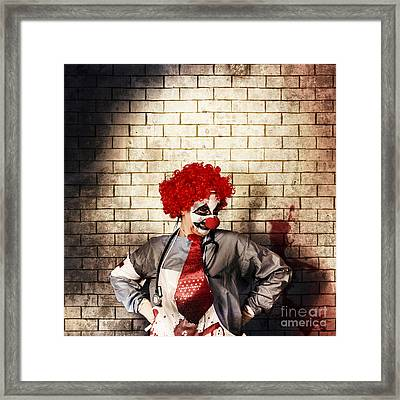 Sinister Gothic Clown Standing On Grunge Brickwall Framed Print