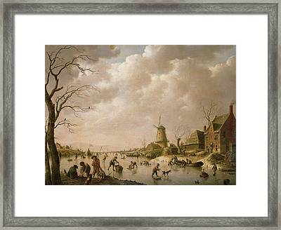 Skaters On A Frozen Canal Framed Print by Hendrik Willem Schweickardt