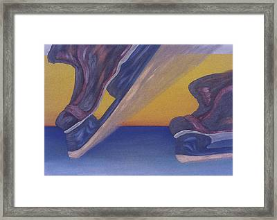 Skates Framed Print by Ken Yackel