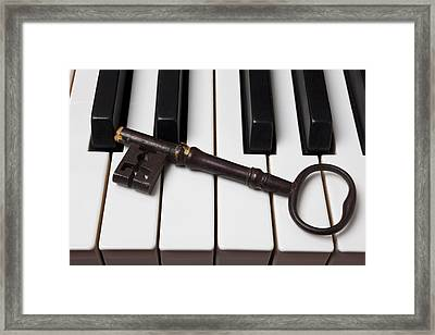 Skeleton Key On Piano Keys Framed Print