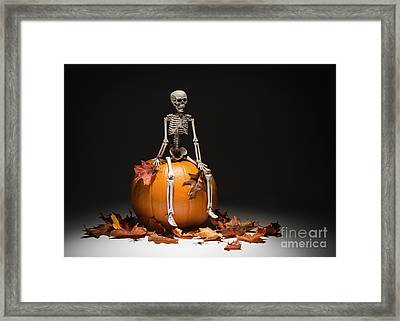 Skeleton With Pumpkin And Leaves Framed Print