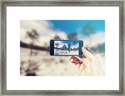 Ski Resort Tourist With Winter Landscape On Phone Framed Print