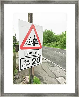 Skid Risk Framed Print by Tom Gowanlock