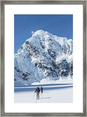 Skiers And Shadows Framed Print
