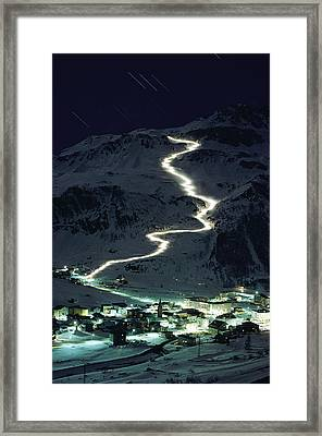 Skiers Bearing Torches Ski Down Mont Framed Print by George F. Mobley