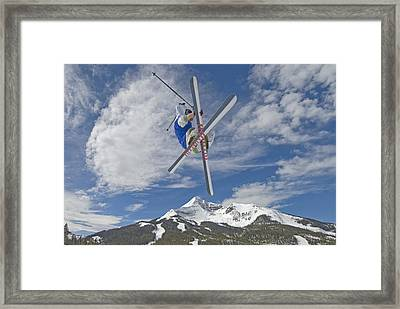 Skiing Aerial Maneuvers Off A Jump Framed Print by Gordon Wiltsie